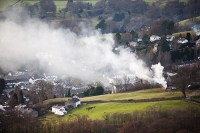 Lake-District;Ambleside;National-park;fire;smoke;pollution;air-pollution;air-quality;smoky;rubbish;burning;environment;drift;drifting;field;house;housing;village