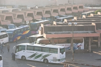 Morocco;North-Africa;arabic;Marrakech;roof;house;fog;smog;air-quality;air-pollution;tree;pollution;exhaust-fumes;bus;coach;bus-station;public-transport;visibility;poor-visibility