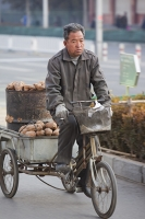 China;person;human;chinese;race;ethnicity;ethnic;cyclist;cycling;bike;bicycle;carbon-footprint;travel;transport;road;Beijing;load;food;farmer