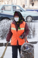 China;person;human;chinese;race;ethnicity;ethnic;cyclist;cycling;bike;bicycle;carbon-footprint;travel;transport;road;Beijing;pollution;air-pollution;exhaust-fumes;polluted;air-quality;face-mask;smog-mask;smog;breathing;woman;road-sweeper;cleaner;brush;high-visibility;protective-clothing;protection