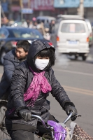 China;person;human;chinese;race;ethnicity;ethnic;cyclist;cycling;bike;bicycle;carbon-footprint;travel;transport;road;Beijing;pollution;air-pollution;exhaust-fumes;polluted;air-quality;face-mask;smog-mask;smog;breathing