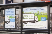 Low-Emmission-Zone;carbon-emmissions;carbon-footprint;C02;grenhouse-gas;poster;hoarding;bus-stop;London;UK;travel;traffic;fossil-fuel;climate-change;global-warming
