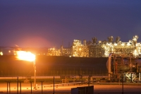 gas;gas-plant;industry;industrial-complex;heavy-industry;pipe;pipeline;plant;chimney;flare;flare-off;flame;fence;security;protection;carbon-footprint;global-warming;climate-change;emissions;C02;carbon-dioxide;fossil-fuel;evening;dusk;glow