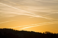 sky;air;contrail;vapour-trail;plane;aviation;pollution;carbon-footprint;C02;atmosphere;global-warming;climate-change;greenhouse-gas;sky;dawn;sunrise;glow;warm;orange;colour;lake-district;Ambleside;Cumbria;UK;criss-cross;flight-path;polluted;pattern;shape;form;cross