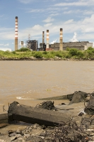 Buenos-Aires;Capital-city;city;Argentina;South-America;Argentinian;town;woodland;forest;green;nature-reserve;Costanera-Sur;tropical;vegetation;reclaimed;Rio-de-la-Plata;River-Plate;river;muddy;embankment;concrete;smoke-stack;chimney;power-station;emissions;C02;climate-change;global-warming;pollution;greenhouse-gas;pollution;reclaimed-land;red