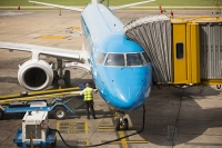 Buenos-Aires;Capital-city;city;Argentina;South-America;Argentinian;town;growth;wealth;economy;modern;airport;plane;airplane;jet;travel;aviation;runway;transport;Ministro-Pistarini-International-Airport;Ezeiza;baggage;luggage;baggage-handler;workman;man;high-vis;PPE;Air-austral;blue;austral