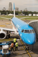 Buenos-Aires;Capital-city;city;Argentina;South-America;Argentinian;town;growth;wealth;economy;modern;airport;plane;airplane;jet;travel;aviation;runway;transport;Ministro-Pistarini-International-Airport;Ezeiza;baggage;luggage;baggage-handler;workman;man;high-vis;PPE;apartment;tower-block;high-rise