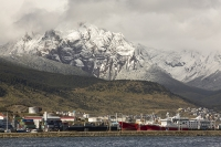 Ushuaia;Tierra-del-Fuego;Argentina;Patagonia;South-America;Austral;town;South;southerly;red;tourism;Isla-Grande-de-Tierra-del-Fuego;Beagle-Channel;Martial-Mountain-Range;travel;mountain;hill;peak;snow;snow-capped;glacier;sky;rock;rugged;mountain-range;ship;boat;docks;dock;wharf;port;rock;folding;srata;geology