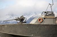 Ushuaia;Tierra-del-Fuego;Argentina;Patagonia;South-America;Austral;town;South;southerly;tourism;Isla-Grande-de-Tierra-del-Fuego;Beagle-Channel;Martial-Mountain-Range;travel;boat;ship;gun;navy;Armada-Argentina;weapon;protection;machine-gun