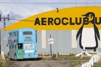 Ushuaia;Tierra-del-Fuego;Argentina;Patagonia;South-America;Austral;town;South;southerly;tourism;Isla-Grande-de-Tierra-del-Fuego;Beagle-Channel;Martial-Mountain-Range;plane;airplane;old;propeller;airport;preserved;museum;travel;yellow;blue;aeroclub;aeroclub-Ushuaia;penguin;hanger;aircraft-hanger;city-tour;tour-bus;tourism