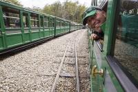 Ushuaia;Tierra-del-Fuego;Argentina;Patagonia;South-America;Austral;travel;tourism;tracks;train;train-tracks;narrow-guage;railway;the-railway-at-the-end-of-the-world;Southern-Fuegian-Railway;Fuegian;fuegian-Railway;steam-train;old;tourist-attraction;railway-carriage;tourist;man;male;happy;smile;head;window