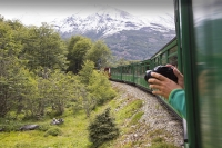Ushuaia;Tierra-del-Fuego;Argentina;Patagonia;South-America;Austral;travel;tourism;tracks;train;train-tracks;narrow-guage;railway;the-railway-at-the-end-of-the-world;Southern-Fuegian-Railway;Fuegian;fuegian-Railway;steam-train;old;tourist-attraction;railway-carriage;forest;woodland;camera;photograph;mountains;snow