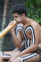 man;male;aboriginal;aborigini;indigenous;Australian;first-nation;paint;make-up;traditional;dress;ethnic;ethnicity;culture;proud;Australia;tourism;didgeridoo;music;playing;sound;dreamtime;song-lines;Tjapukai;Tjapukai-Aboriginal-park;Cairns;Queensland