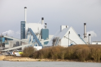 20130130_IMG_2646.jpg The new biofuel power plant at the Iggesund paper board manufacturer in Workington, Cumbria, UK with wind turbines behind. When commissioned the power station will fuel the pant as well as feeding power into the grid.