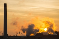 20130218_B18A0070.jpg Sunset over the Iggesund paper board manufacturer in Workington, Cumbria, UK, at sunset, with wind turbines. The plant is powered by a biofuel power station, on site.