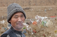 China;chinese;rubbish;litter;plastic;environment;polluted;pollution;degraded;waste;Inner-Mongolia;wind;man;chinese;smoking;cigarette;cancer;unhealthy;face;smile;happy;habit;addict;addicted;nicotine
