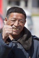 China;person;human;chinese;race;ethnicity;ethnic;weathered;man;male;face;smile;happy;lined;coat;overcoat;thumbs-up;OK;gesture;teeth;dental-hygiene