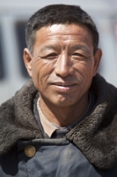 China;person;human;chinese;race;ethnicity;ethnic;weathered;man;male;face;smile;happy;lined;coat;overcoat