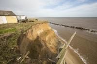 defences;sea;sea-defences;global-warming;sea-level-rise;erosion;coastal-erosion;glacial;till;deposits;beach;cliff;collapse;coast;Happisburgh;Norfolk;sea-defences;rapid-erosion;threat;vulnerable;edge;sea-level-rise;crumbling;soft;house;shack;remains