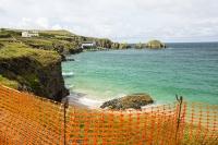 Cornwall;UK;coast;edge;Trevose-Head;orange;netting;fence;collapse;coastal-erosion;RNLI;lifeboat-station;Padstow;Padstow-lifeboat;sea;Atlantic-Ocean;turquoise;aquamarine;house;headland;location;sea-cliff