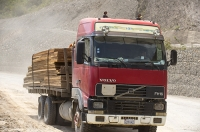 Bolivia;South-America;mountains;forest;rain-forest;tropical;altitude;high;Coiroca;deforestation;tropical-rain-forest;Amazon;Amazon-rain-forest;destruction;clear-felling;chopped-down;road;dusty;truck;lorry;haulage;plank;tropical-hard-wood;timber;lumber