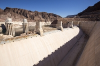 USA;US;America;Nevada;desert;Lake-Mead;electricity;generating;renewable;renewable-energy;carbon-neutral;climate-change;global-warming;pylon;HEP;hydro;hydro-power;drought;transmission;dam;dam-wall;concrete;ravine;rock;geology;road;overspill;overflow;intake-pipe;white;line;exposed;Hoover-Dam;intake-pipe;tower