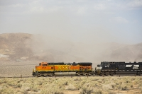 USA;US;America;California;Mojave-Desert;desert;sand;dry;scrub;bush;vegetation;tumble-weed;sky;cloud;dust;dusty;air-pollution;dust-storm;drought;climate-change;global-warming;bridge;railway;railroad;BNSF;orange;locomotive;engine;power;powerful
