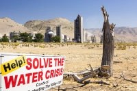 USA;US;America;California;Mojave-Desert;desert;climate-change;global-warming;Tehachapi-Pass;cement;cement-works;factory;dirty;polluting;carbon-intensive;coal;power;energy;fossil-fuel;ranchland;farmland;dry;dessicated;dry;drought;killed;dead;tree;irony;ironic;cause-and-affect;cause-and-effect;red;sign;composite;water-crisis;crisis