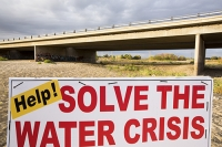 USA;US;America;California;brown;drought;dessicated;dried-up;climate-change;global-warming;parched;Kern-County;Kern-River;river-bed;burnt;Bakersfield;bridge;road;crossing;red;sign;composite;water-crisis;crisis
