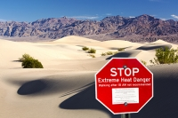 California;USA;America;Death-Valley;desert;drought;hot;dry;low;heat;National-Park;preserved;protected;mud-cracks;lake-bed;dessicated;barren;mountain;mountain-range;geology;rocks;sand;sandy;tumble-weed;tumbleweed;sand-dunes;Mesquite-Falt;ripples;ripple-marks;sand-ripples;crest;dune-crest;windswept;wind;movement;wind-erosion;footsteps;shade;composite;red;sign;warning;danger;extreme-heat