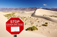 California;USA;America;Death-Valley;desert;drought;hot;dry;low;heat;National-Park;preserved;protected;mud-cracks;lake-bed;dessicated;barren;mountain;mountain-range;geology;rocks;sand;sandy;tumble-weed;tumbleweed;sand-dunes;Mesquite-Falt;ripples;ripple-marks;sand-ripples;crest;dune-crest;windswept;wind;movement;wind-erosion;footsteps;composite;red;sign;warning;danger;extreme-heat