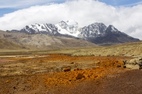 South-America;Bolivia;La-Paz;Huayna-Potosi;El-Alto;mountain;altitude;high;glacial-retreat;climate-change;global-warming;mountain-range;Cordillera-Real;Altiplano;water-supply;grass;grassland;reservoir;water-supply;low;drought;Laguna-Miluni;Miluni;colour;colourful;iron;iron-staining;red;orange;pink;purple;discoloured;mining;mine-effluent;polluted;pollution;contaminated;snow-pack;snow-capped;snow-cover;glacier