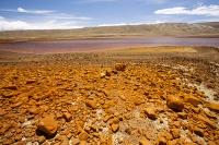 South-America;Bolivia;La-Paz;Huayna-Potosi;El-Alto;mountain;altitude;high;glacial-retreat;climate-change;global-warming;mountain-range;Cordillera-Real;Altiplano;water-supply;grass;grassland;reservoir;water-supply;low;drought;Laguna-Miluni;Miluni;colour;colourful;iron;iron-staining;red;orange;pink;purple;discoloured;mining;mine-effluent;polluted;pollution;contaminated;drought
