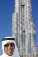 Dubai;Middle-East;arabic;high-rise;tower-block;development;luxury;wealthy;expensive;architecture;design;construction;building;building-site;Emirates;Burj-Dubai;crane;tall;tallest;carbon-footprint;helicopter;man;male;arab;arabic;white;robe;sunglasses