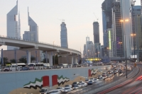 Dubai;Middle-East;arabic;road;highway;car;car-culture;lane;gas-guzzlers;climate-change;global-warming;pollution;travel;transport;exhaust;carbon-footprint;C02;emmissions;rush-hour;busy;high-rise;tower-block;development;luxury;wealthy;expensive;architecture;design;lights;evening;dusk;movement