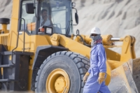 Dubai;hotel;development;resort;holiday;building;architecture;Emirates;reclaim;beach;workers;muslim;arab;arabic;construction-site;hard-hat;helmet;health-and-safety;protection;overalls;men;man;male;yellow;digger;JCB;machine;bulldozer