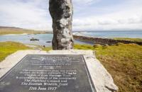 Eigg;island;Scotland;UK;Eigg-Heritage-Trust;community;highland;coast;Galmisdale;stone;standing-stone;plaque;memorial;ancient;pride;buy-out;harbour;plaque;partnership