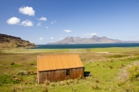 Eigg;island;Scotland;UK;Eigg-Heritage-Trust;community;highland;coast;sea;Hebrides;Inner-Hebrides;bay;Laig;Laig-Bay;Bay-of-Laig;barn;croft;crofting;farm;farming;ban;rust;rusty;rusting;corrugated-iron;corrugated-metal;sheet;Rhum;Isle-of-Rhum;mountains;Rhum-Cuillin;West;landscape;green;pasture