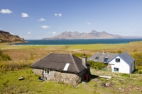 Eigg;island;Scotland;UK;Eigg-Heritage-Trust;community;energy;power;electric;electricity;renewable;renewable-energy;renewable-power;wind-power;solar-power;hydro;hydro-power;clean;green;zero-emissions;climate-change;global-warming;carbon-footprint;feed-in-tariff;future;Eigg-electric;self-sufficient;self-sufficiency;lifestyle;environment;eco;house;household;solar-thermal;solar-panel;solar-power;hot-water;water-heater;evacuated-tubes;view;locaion;vista;outlook;Rhum;Cuillins;mountain;Atlantic;bay;Laig;croft;crofting