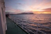 Argentina;South-America;Austral;coast;island;island-chain-Falkland;Falklands;Falkland-Islands;Malvinas;sky;cloud;orange;glow;dawn;sunrise;South-Atlantic;ocean;ship;deck;boat;railings