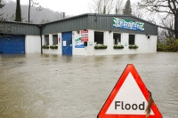 Floods;flooding;flooded;Ambleside;Cumbria;Lake-District;UK;weather;extreme-weather;climate-change;global-warming;deluge;torrential-rain;downpour;meteorology;low-pressure;weather-front;rain;raining;heavy-rain;precipitation;wet;sodden;house;flooded-house;insurance;insurance-claim;flood-damage;unit;play-centre;for-sale;flood-victim;sign;road-sign;warning;triangle;composite
