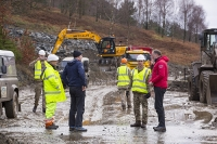 Floods;flooding;flooded;Cumbria;Lake-District;UK;weather;extreme-weather;climate-change;global-warming;deluge;torrential-rain;downpour;meteorology;low-pressure;weather-front;flood-waters;Thirlmere;A591;road;swept-away;undermined;flood-damage;road-closed;power;car;flood;landrover;vehicle;abandoned;emergency;emergency-services;Army;soldier;British-Army;emergency;bulldozer;shovel;clearing;clearup;cleanup;plant;heavy-machinery;red;yellow