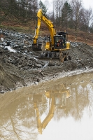 Floods;flooding;flooded;Cumbria;Lake-District;UK;weather;extreme-weather;climate-change;global-warming;deluge;torrential-rain;downpour;meteorology;low-pressure;weather-front;flood-waters;Thirlmere;A591;road;swept-away;undermined;flood-damage;road-closed;power;car;flood;vehicle;emergency;emergency-services;emergency;bulldozer;shovel;clearing;clearup;cleanup;plant;heavy-machinery;yellow;reflection;flood-water;mud;muddy