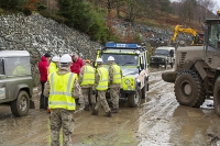 Floods;flooding;flooded;Cumbria;Lake-District;UK;weather;extreme-weather;climate-change;global-warming;deluge;torrential-rain;downpour;meteorology;low-pressure;weather-front;flood-waters;Thirlmere;A591;road;swept-away;undermined;flood-damage;road-closed;power;car;flood;landrover;mountain-rescue;vehicle;abandoned;emergency;emergency-services;Army;soldier;British-Army;emergency;bulldozer;shovel;clearing;clearup;cleanup;plant;heavy-machinery;red;yellow;high-vis;PPE;helemt;health-and-safety;mud;muddy