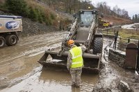 Floods;flooding;flooded;Cumbria;Lake-District;UK;weather;extreme-weather;climate-change;global-warming;deluge;torrential-rain;downpour;meteorology;low-pressure;weather-front;flood-waters;Thirlmere;A591;road;swept-away;undermined;flood-damage;road-closed;power;car;flood;vehicle;emergency;emergency-services;Army;soldier;British-Army;emergency;bulldozer;shovel;clearing;clearup;cleanup;plant;heavy-machinery;red;yellow;high-vis;PPE;helemt;health-and-safety;mud;muddy
