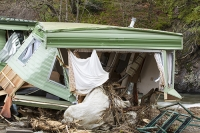 Floods;flooding;flooded;Cumbria;Lake-District;UK;Keswick;weather;extreme-weather;climate-change;global-warming;deluge;torrential-rain;downpour;meteorology;low-pressure;weather-front;rain;raining;heavy-rain;precipitation;flood-waters;river;swept-away;undermined;flood-damage;power;caravan;mobile-home;static-caravan;destroyed;destruction;flood-damage;ripped-apart;insurance;insurance-claim;caravan-park;River-Greta;aluminium
