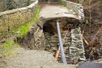Floods;flooding;flooded;Cumbria;Lake-District;UK;Keswick;weather;extreme-weather;climate-change;global-warming;deluge;torrential-rain;downpour;meteorology;low-pressure;weather-front;rain;raining;heavy-rain;precipitation;flood-waters;river;swept-away;undermined;flood-damage;power;destroyed;destruction;flood-damage;ripped-apart;River-Greta;stone;collapsed;bridge;stone-bridge;old;ancient;crossing;shut;pipe;infrastructure;Forge-Lane;Forge-Lane-Bridge