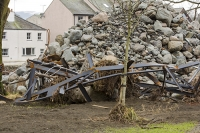 Floods;flooding;flooded;Cumbria;Lake-District;UK;Keswick;weather;extreme-weather;climate-change;global-warming;deluge;torrential-rain;downpour;meteorology;low-pressure;weather-front;rain;raining;heavy-rain;precipitation;flood-waters;river;swept-away;undermined;flood-damage;power;destroyed;destruction;flood-damage;ripped-apart;River-Greta;debris;tree;flood-debris;sediment;Fitz-Park;boulder;pile;rock;stone;metal;caravan-chassis