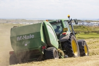 Walney;Walney-island;electricity;hay;hay-bale;field;grass;crop;fodder;farming;summer;harvest;round;farmer;machinery;plany;tractor;man;male;gathering;harvest;harvesting;animal-food;drying;grass;field;hay-meadow;dust;dusty;hay-fever