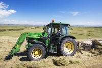 Walney;Walney-island;electricity;hay;hay-bale;field;grass;crop;fodder;farming;summer;harvest;round;farmer;machinery;plany;tractor;man;male;gathering;harvest;harvesting;animal-food;drying;grass;field;hay-meadow